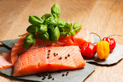 Salmon fillet ready to cook. Salmon fillet on flat rocks ready to cook Royalty Free Stock Photo
