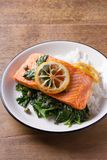 Salmon fillet with rice, spinach and lemon. Salmon with garnish. Fish for healthy dinner. Salmon fillet with rice, spinach and lemon. Salmon with garnish. Fish Stock Images