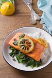 Salmon fillet with rice, spinach and lemon. Salmon with garnish. Fish for healthy dinner. Salmon fillet with rice, spinach and lemon. Salmon with garnish. Fish Royalty Free Stock Photos