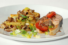 Salmon fillet on roasted potato and vegetable Royalty Free Stock Image