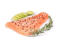 Salmon fillet with rosemary and lemon. Isolated on a white background Royalty Free Stock Photography