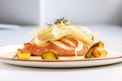 Salmon fillet with salad of fennel on resturant stock photography