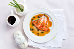 Salmon fillet with sauce Stock Images