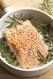 Salmon Fillet with Sesame Seeds and Herbs. In white frypan Stock Photo