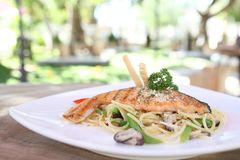 Salmon fillet with spaghetti. Onn a plate royalty free stock image