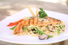 Salmon fillet with spaghetti. On a plate stock photos