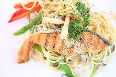 Salmon fillet with spaghetti. In close up stock photos