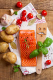 Salmon fillet with spatula, spices and vegetables Stock Photography