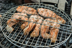 Salmon fillet steak on the grill with smoke Royalty Free Stock Images