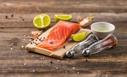 Salmon fillet on table with cut lemon Royalty Free Stock Photography