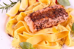 Salmon fillet on tagliatelle with lemon and herbs Stock Image