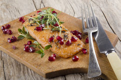 Salmon fillet, thyme and pomegranate seed Royalty Free Stock Image