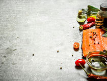 Salmon fillet with tomatoes, olive oil and spices. Stock Photo
