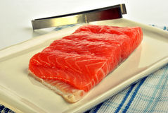 Salmon fillet and a tongs Royalty Free Stock Photo