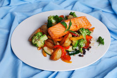 Salmon fillet with vegetables and basil Stock Photo
