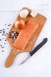 Salmon fillet on a wooden board Stock Images