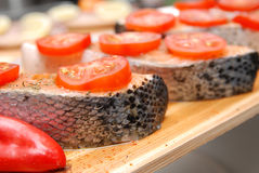 Salmon fillets. A raw Salmon fillets with tomatoes, ready to grill. Close up Stock Photography