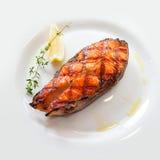 Salmon fillets. Appetizing salmon fillets with lemon Stock Photography