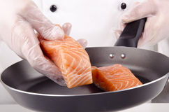 Salmon fillets for frying in a pan Stock Photo
