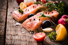 Salmon fillets. Raw salmons fillets on wooden background,selective focus Royalty Free Stock Image