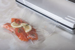 Salmon fillets in a vacuum package. Sous-vide, new technology c Stock Image
