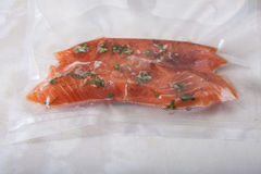 Salmon fillets in a vacuum package. Stock Photo
