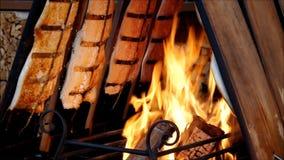 Salmon on fire. On christmas market stock video