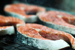Salmon on the fire. Fresh salmon cooked on fire Stock Photo