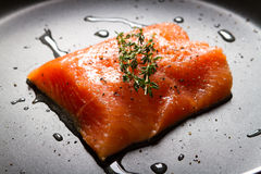 Salmon fish. Fresh salmon fish fillet on a frying pan Stock Photos
