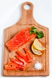 Salmon fish on board Royalty Free Stock Photo