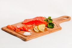 Salmon fish on board Royalty Free Stock Images