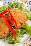 Salmon fish cake on salad Royalty Free Stock Images