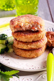 Salmon fish cakes on plate Royalty Free Stock Image
