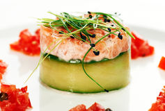 Salmon fish dish. Decorated on a white plate Stock Photos
