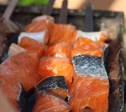 Salmon fish on fire. Salmon fish is  cooking on a grill Stock Images