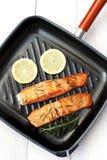 Salmon fish with fresh herbs, lemon Stock Photography
