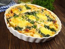 Salmon - Fish Gratin with Spinach royalty free stock image