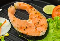 The salmon fish on a pan. Stock Images