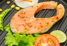 The salmon fish on a pan. Stock Photo