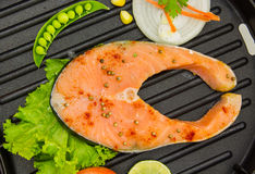 The salmon fish on a pan. Royalty Free Stock Photos