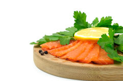 Salmon Fish with parsley and lemon. Sea food on the white background stock photo