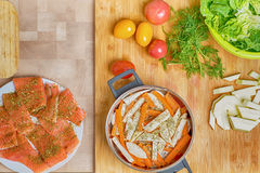 Salmon fish preparation for cooking, chopped vegetables, salt and knife Stock Photography