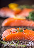 Salmon Fish..Raw salmon fillet pepper salt dill lemon rosemary on wooden table Stock Photography