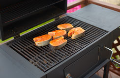 Salmon fish roast on barbecue grill. Royalty Free Stock Image