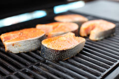 Salmon fish roasted on barbecue grill. Royalty Free Stock Images