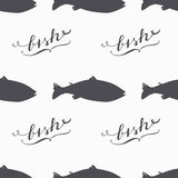 Salmon fish silhouette hand drawn seamless pattern in hipster style. Handwritten sign Stock Images