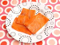 Salmon Fish. Some fresh salmon fish in oil on a plate Stock Images