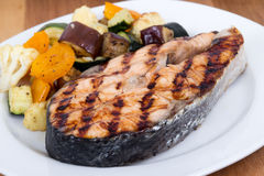 Salmon fish steak meal with vegetables Stock Image