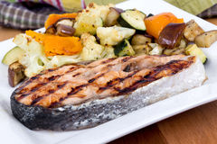 Salmon fish steak meal with vegetables Royalty Free Stock Image