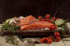 Salmon fish with vegetables and spice Royalty Free Stock Images